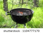 barbecue grill with flame... | Shutterstock . vector #1104777170