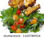 a very tasty salad | Shutterstock . vector #1104780926
