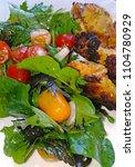 a very tasty salad | Shutterstock . vector #1104780929
