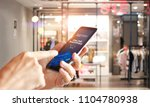 man using mobile payments... | Shutterstock . vector #1104780938