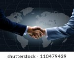 Handshake With Map Of The World ...