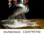 pastry chef 's hands is making... | Shutterstock . vector #1104795740