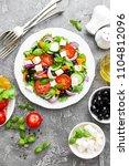 greek salad. fresh vegetable... | Shutterstock . vector #1104812096