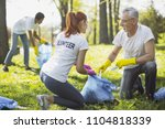 non profit volunteer. vigorous... | Shutterstock . vector #1104818339