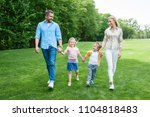 happy family holding hands and... | Shutterstock . vector #1104818483