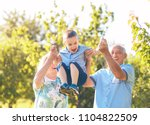 grandparents with grandson... | Shutterstock . vector #1104822509