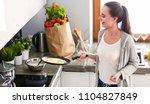 young woman prepares pancakes...   Shutterstock . vector #1104827849
