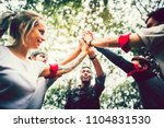 outdoor teambuilding activity... | Shutterstock . vector #1104831530