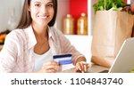 smiling woman online shopping... | Shutterstock . vector #1104843740