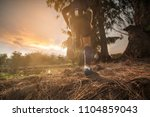 trail running at the sunset | Shutterstock . vector #1104859043