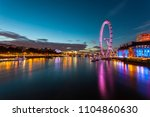 london eye at night with...
