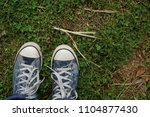 pair of sport shoes on a... | Shutterstock . vector #1104877430