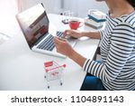 woman and small shopping cart... | Shutterstock . vector #1104891143