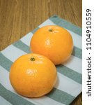 two fresh ripe and sweet...   Shutterstock . vector #1104910559