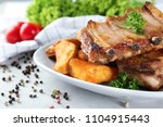 plate with delicious grilled... | Shutterstock . vector #1104915443