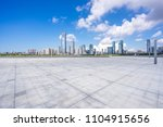 empty square with city skyline | Shutterstock . vector #1104915656