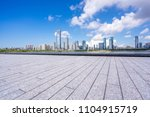 empty square with city skyline   Shutterstock . vector #1104915719