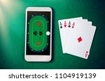 mobile casino. poker table on... | Shutterstock . vector #1104919139