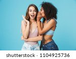 two cheerful young girls... | Shutterstock . vector #1104925736