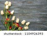 beautiful tulips on wooden... | Shutterstock . vector #1104926393