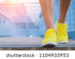close up of man's running shoes ... | Shutterstock . vector #1104933953