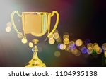 gold trophy cup with black and ... | Shutterstock . vector #1104935138