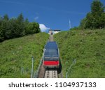 a wagon on the way up a... | Shutterstock . vector #1104937133