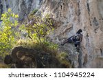 young man looking up while... | Shutterstock . vector #1104945224