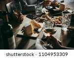 wine and cheese served for a... | Shutterstock . vector #1104953309