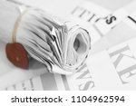 stack of rolled and folded... | Shutterstock . vector #1104962594