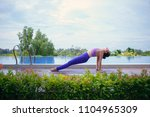 woman playing yoga pose beside... | Shutterstock . vector #1104965309