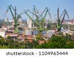 cranes of the shipyard in... | Shutterstock . vector #1104965444