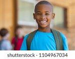 smiling african american school ... | Shutterstock . vector #1104967034