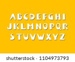 vector bold cut out alphabet.... | Shutterstock .eps vector #1104973793