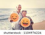 seniors enjoying a tropical... | Shutterstock . vector #1104976226