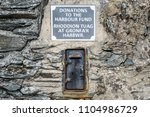 an old iron donation box set in ... | Shutterstock . vector #1104986729