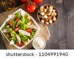 fresh caesar salad with... | Shutterstock . vector #1104991940