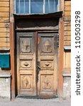 old door and window closeup of wooden building - stock photo