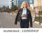 fashion woman in black leather... | Shutterstock . vector #1105035419