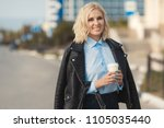 fashion woman in black leather... | Shutterstock . vector #1105035440