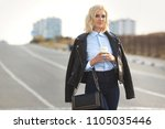 beautiful blonde woman cross... | Shutterstock . vector #1105035446