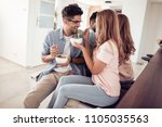 family  holiday and people... | Shutterstock . vector #1105035563