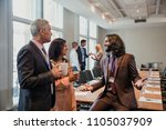 small group of business men and ... | Shutterstock . vector #1105037909