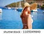 redhair woman in bikini relaxed ...   Shutterstock . vector #1105049840