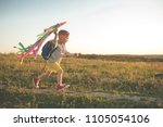 happy child playing with a kite ... | Shutterstock . vector #1105054106