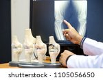doctor pointing on the knee... | Shutterstock . vector #1105056650