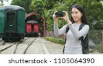 woman taking photo with camera...   Shutterstock . vector #1105064390