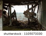 destroyed wall of a house | Shutterstock . vector #1105073330