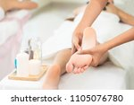 foot spa massage treatment by... | Shutterstock . vector #1105076780