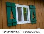 cabin window shutters green...   Shutterstock . vector #1105093433